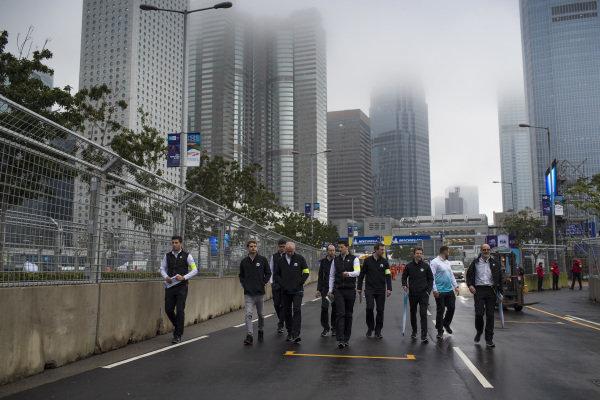 Tom Dillmann (FRA), NIO Formula E Team, and Oliver Turvey (GBR), NIO Formula E Team, walk the track with their team