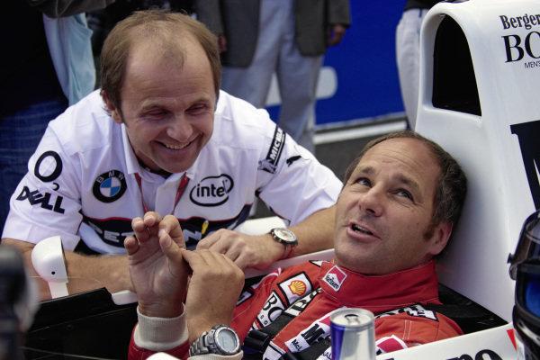 Gerhard Berger in the cockpit of his original 1991 McLaren-Honda under the watchful eye of Jo Leberer, his physiotherapist.