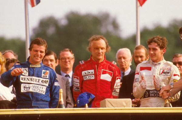 Brands Hatch, England.20-22 July 1984.Niki Lauda (McLaren TAG Porsche) 1st position, Derek Warwick (Equipe Renault) 2nd position and Ayrton Senna (Toleman Hart) 3rd position on the podium.Ref-84 GB 14.World Copyright - LAT Photographic