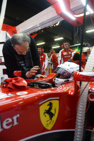 Sergio Marchionne in the garage with Sebastian Vettel.