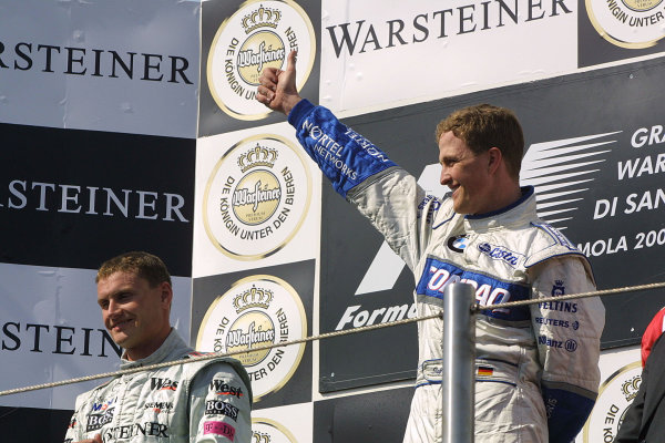 2001 San Marino Grand Prix.Imola, Italy. 13-15 April 2001.Ralf Schumacher (Williams BMW) 1st position and David Coulthard (McLaren Mercedes) 2nd position on the podium.World Copyright - Steve Etherington/LAT Photographicref: 9 mb digital image.