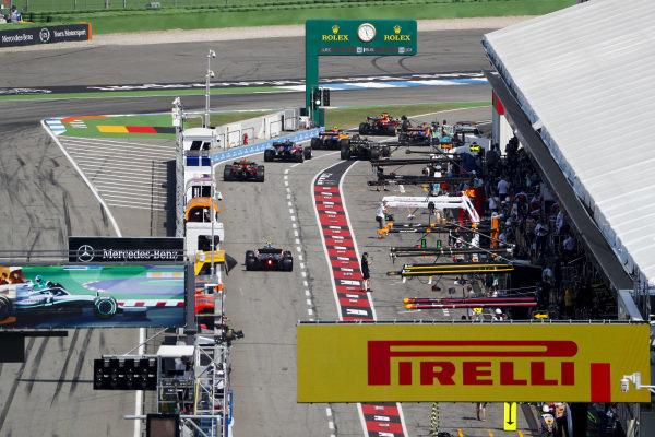 Carlos Sainz Jr., McLaren MCL34, Max Verstappen, Red Bull Racing RB15, Lando Norris, McLaren MCL34, Alexander Albon, Toro Rosso STR14, Nico Hulkenberg, Renault R.S. 19, and Pierre Gasly, Red Bull Racing RB15, queue to leave the pits