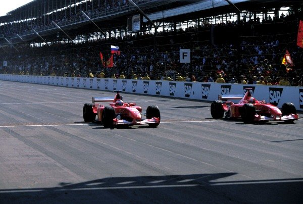 Michael Schumacher (GER) Ferrari F2002 and team mate Rubens Barrichello (BRA) Ferrari F2002 cross the line just 0.010 seconds apart for the closest finish in F1 history. Formula One World Championship, Rd16, United States Grand Prix, Indianapolis, USA, 29 September 2002. BEST IMAGE