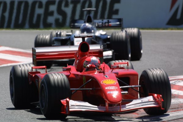 2001 French Grand Prix - RaceMagny-Cours, France. 1st July 2001Michael Schumacher, Ferrari F2001, leads David Coulthard, West McLaren Mercedes MP4/16, action.World Copyright - LAT Photographicref: 8 9 MB Digital File only