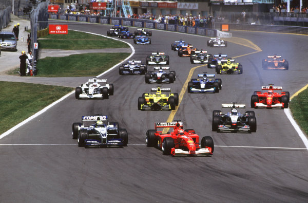 2001 Canadian Grand PrixMontreal, Canada. 8th-10th June 2001Michael Schumacher, Ferrari F2001, leads brother Ralf Schumacher, BMW Williams FW23, and David Coulthard, West McLaren Mercedes MP4/16, at the start of the race.World Copyright: LAT Photographicref: 35mm Image A23