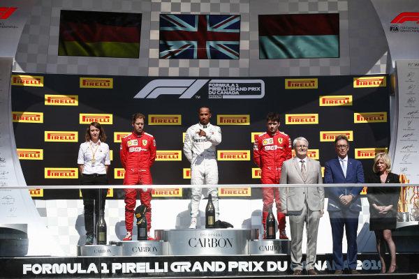 Sebastian Vettel, Ferrari, Lewis Hamilton, Mercedes AMG F1 and Charles Leclerc, Ferrari on the podium