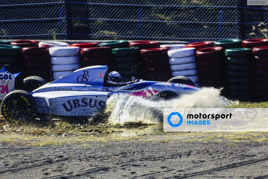 Bertrand Gachot, Pacific PR01 Ilmor, goes through a puddle after going off the track.