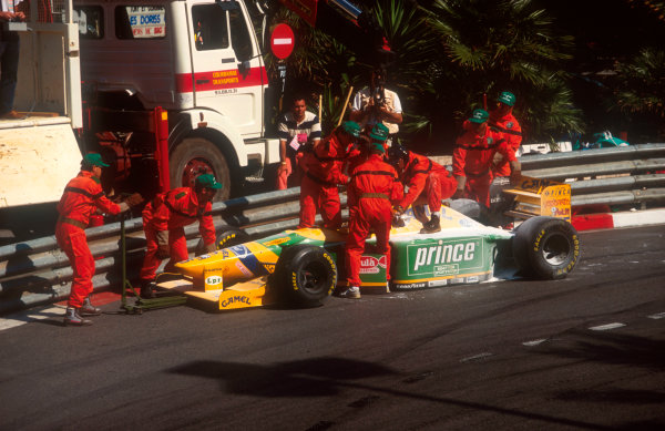 1993 Monaco Grand Prix.Monte Carlo, Monaco.20-23 May 1993.Marshals get Michael Schumacher's Benetton B193B Ford off of the track after he exited the race while leading, due to an hydraulic oil line detached and the fluid caught fire, sending him straight on at Loews Hairpin.Ref-93 MON 13.World Copyright - LAT Photographic