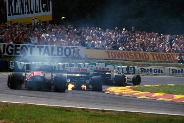 The flame spitting Williams FW11 of Nigel Mansell (GBR) leads the smoking Ferrari F186. British GP, Brands Hatch,  13th July 1986