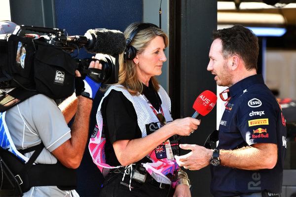 Louise Goodman (GBR) talks with Christian Horner (GBR) Red Bull Racing Team Principal