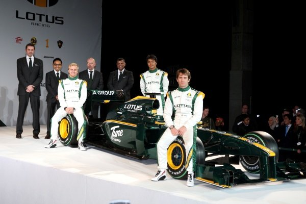 The new Lotus T127 with (L to R): Keith Saunt (GBR) Chief Operating Officer, Riad Asmat (MAL) CEO Lotus Racing, Mike Gascoyne (GBR) Lotus F1 Racing Chief Technical Officer, Tony Fernandes (MAL), Heikki Kovalainen (FIN), Fairuz Fauzy (MAL) Lotus F1 Racing test driver and Jarno Trulli (ITA) Lotus.Lotus T127 Launch, Royal Horticultural Halls, London, 12 February 2010.