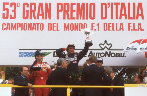 Monza, Italy.10-12 September 1982.Rene Arnoux (Equipe Renault) 1st position, Patrick Tambay  2nd position and Mario Andretti 3rd position (both Ferrari) on the podium.Ref-82 ITA 06.World Copyright - LAT Photographic