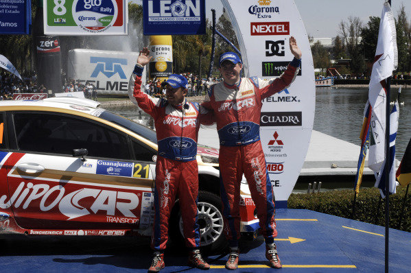 Martin Prokop (CZE) and Jan Tomanek (CZE) on the podium.  They were handed the S2000 class win when Nasser Al-Attiyah (QAT) was excluded for a technical infringement.