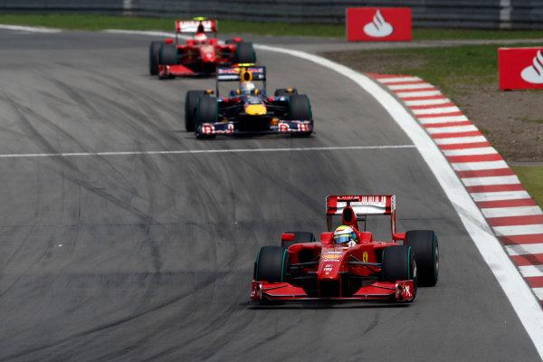 Nurburgring, Germany12th July 2009Felipe Massa, Ferrari F60, 3rd position, leads Sebastian Vettel, Red Bull Racing RB5 Renault, 2nd position, and Kimi Raikkonen, Ferrari F60, retired. Action. World Copyright: Andrew Ferraro/LAT Photographicref: Digital Image _H0Y3099