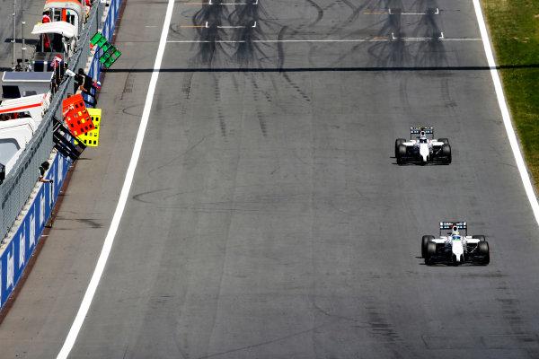Red Bull Ring, Spielberg, Austria. Sunday 22 June 2014. Felipe Massa, Williams FW36 Mercedes, leads Valtteri Bottas, Williams FW36 Mercedes. World Copyright: Glenn Dunbar/LAT Photographic. ref: Digital Image _89P7689