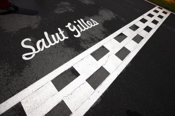 Circuit Gilles Villeneuve, Montreal, Canada 9th June 2011 Salut Gilles written on the main straight, as a tribute Gilles Villeneuve. Detail. World Copyright: Steve Etherington/LAT Photographic ref: Digital Image SNE27630
