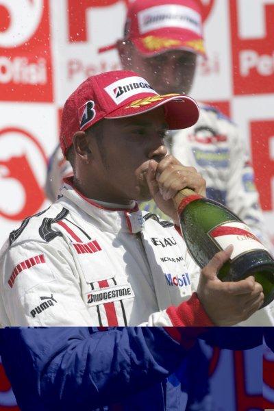 2006 GP2 Series. Round 10.Istanbul Park, Istanbul Turkey.27th August 2006.Sunday Race.Lewis Hamilton (GBR, ART Grand Prix) celebrates his second position. World Copyright: Charles Coates/GP2 Series Media Service.ref: Digital Image MB5C8604