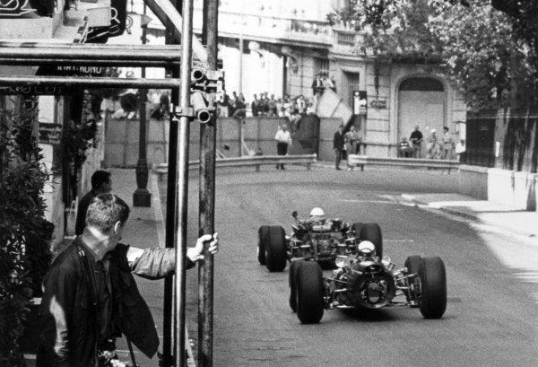 1966 Monaco Grand Prix.Monte Carlo, Monaco. 22 May 1966.Guy Ligier, Cooper T81-Maserati, not classified, leads Jackie Stewart, BRM P261, 1st position, action.World Copyright: LAT PhotographicRef: b&w print