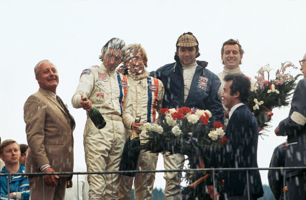 Spa-Francorchamps, Belgium. 9th May 1971.L to R: Jo Siffert, Derek Bell, Pedro Rodriguez and Jackie Oliver share the Champagne after finishing 1-2 in the race, podium.World Copyright: LAT Photographic.Ref: 71SCARS