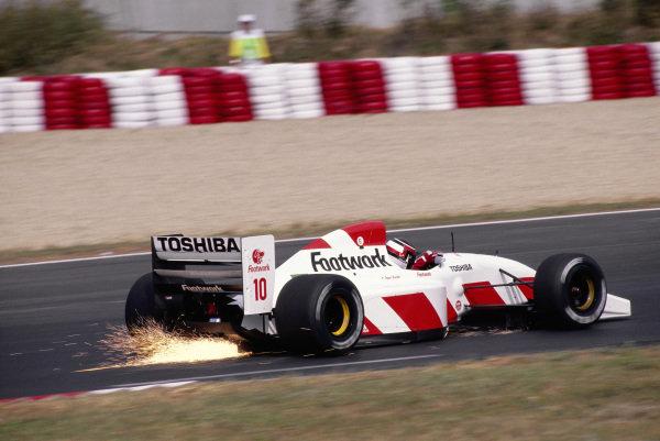 Aguri Suzuki, Footwork FA13 Mugen-Honda, with sparks flying.