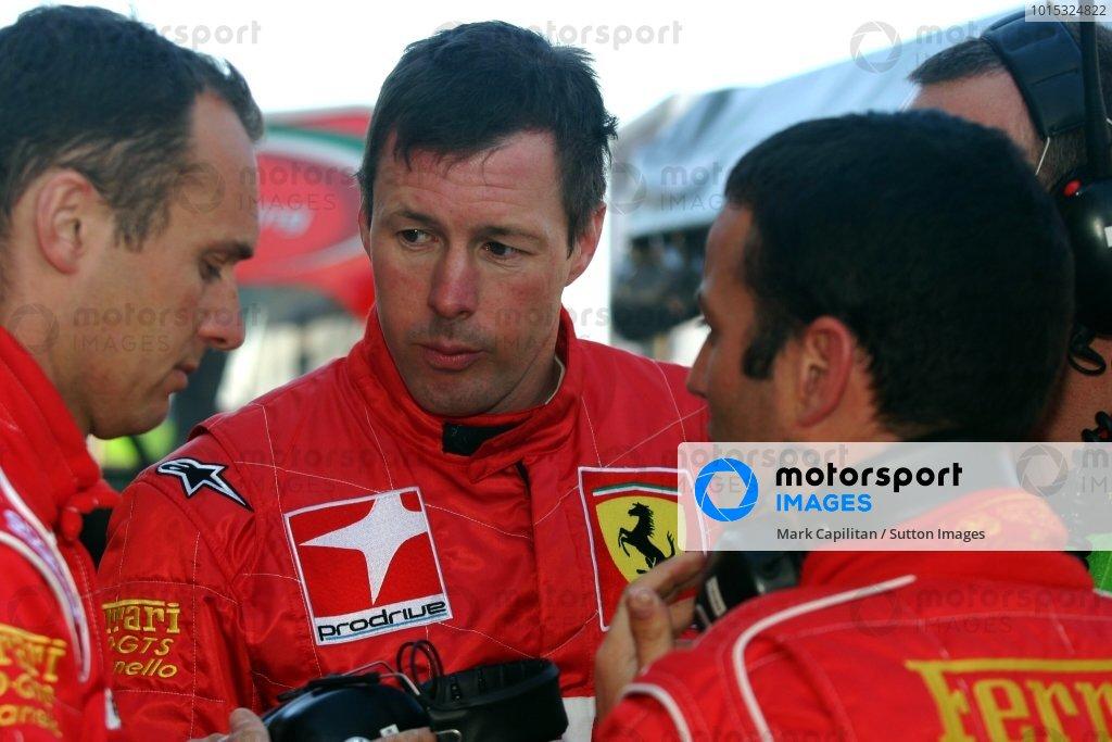 L-R: Prodrive drivers Rickard Rydell (SWE), Colin McRae (GBR) and Darren Turner (GBR) discuss tactics during warm-up.Le Mans 24 Hours, Le Mans, France, 12-13 June 2004.DIGITAL IMAGE