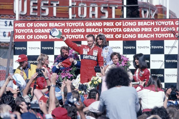 1982 Long Beach Grand Prix.Long Beach, United States. 4 April 1982.Niki Lauda, McLaren MP4/1B-Ford, 1st position, Keke Rosberg, Williams FW07C-Ford, 2nd position, and Gilles Villeneuve, Ferrari 126C2, disqualified, on the podium.World Copyright: LAT PhotographicRef: 35mm transparency 82LB