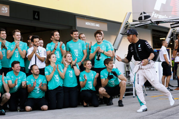 Suzuka Circuit, Suzuka, Japan.  Sunday 27 September 2015. Lewis Hamilton, Mercedes AMG, 1st Position, and the Mercedes team celebrate. World Copyright: Alastair Staley/LAT Photographic ref: Digital Image _79P8463