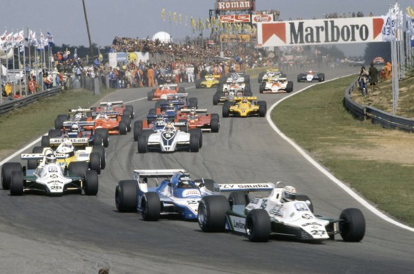 1980 Belgian Grand Prix.Zolder, Belgium. 2-4 May 1980.Alan Jones (Williams FW07B-Ford Cosworth) leads Jacques Laffite (Ligier JS11/15-Ford Cosworth), Carlos Reutemann (Williams FW07B-Ford Cosworth), Rene Arnoux (Renault RE20), Elio de Angelis (Lotus 81-Ford Cosworth), Nelson Piquet (Brabham BT49-Ford Cosworth), Jean-Pierre Jarier (Tyrrell 010-Ford Cosworth) and Patrick Depailler (Alfa Romeo 179B)  at the start.World Copyright: LAT PhotographicRef: 35mm transparency 80BEL09