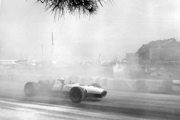 1967 Monaco Grand Prix.Monte Carlo, Monaco. 7 May 1967.John Surtees, Honda RA273, retired, through the smoke caused by Bandini's accident, action.World Copyright: LAT PhotographicRef: Autosport b&w print