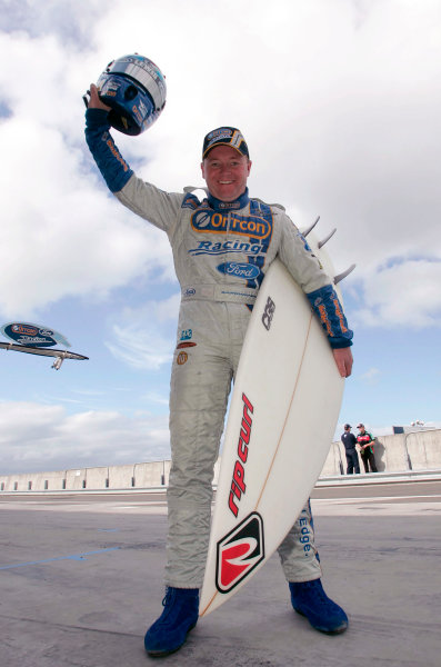 2004 Australian V8 SupercarsSymmons Plain Raceway, Tasmania. November 14th.Jason Bargwanna (Ford Falcon BA) holds a surfboard and his helmet. Portrait.World Copyright: Mark Horsburgh/LAT Photographicref: Digital Image Only
