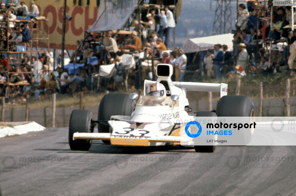1974 South African Grand Prix. Kyalami, South Africa. 30th March 1974. Mike Hailwood (McLaren M23-Ford), 3rd position, action.  World Copyright: LAT Photographic. ref: 35mm Transparency Image