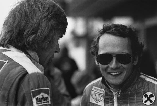 Jarama, Spain. 2nd May 1976.  James Hunt (McLaren M23-Ford), 1st position, shares a joke with Niki Lauda (Ferrari 312T2), 2nd position, portrait.  World Copyright: LAT Photographic.  Ref:  8557 - 33A.