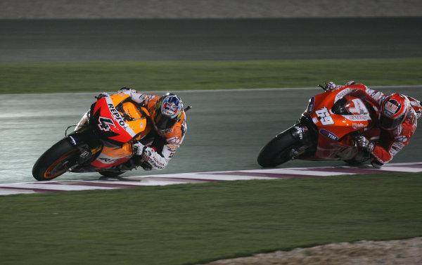 Losail International Circuit, Qatar.Round 1. 9th - 11th April 2010.Andrea Dovizioso Repsol Honda Team leads Nicky Hayden Ducati Marlboro Team.World Copyright: Martin Heath/LAT Photographicref: Digital Image SE5K6664