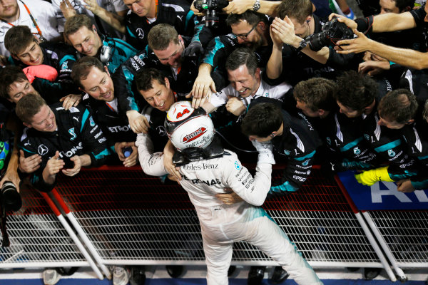 Bahrain International Circuit, Sakhir, Bahrain. Sunday 19 April 2015. Lewis Hamilton, Mercedes AMG, 1st Position, celebrates in Parc Ferme with his team. World Copyright: Steven Tee/LAT Photographic. ref: Digital Image _X0W2394