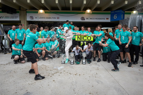 Interlagos, Sao Paulo, Brazil. Sunday 15 November 2015. Nico Rosberg, Mercedes AMG, 1st Position, and the Mercedes team celebrate victory. World Copyright: Steve Etherington/LAT Photographic ref: Digital Image SNE13164