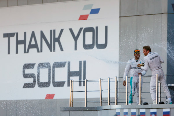 Sochi Autodrom, Sochi, Russia. Sunday 1 May 2016. Nico Rosberg, Mercedes AMG, 1st Position, and Lewis Hamilton, Mercedes AMG, 2nd Position, celebrate on the podium. World Copyright: Andy Hone/LAT Photographic ref: Digital Image _ONY9153