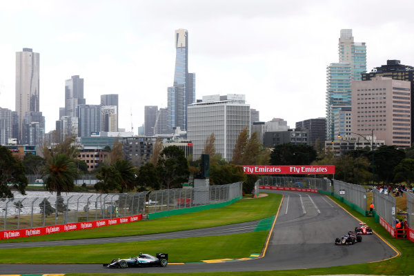 Albert Park, Melbourne, Australia. Friday 18 March 2016. Lewis Hamilton, Mercedes F1 W07 Hybrid, leads Max Verstappen, Toro Rosso STR11 Ferrari. World Copyright: Andy Hone/LAT Photographic ref: Digital Image _ONY2495