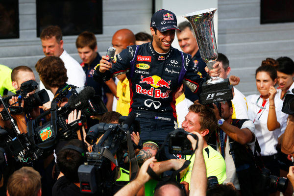 Hungaroring, Budapest, Hungary. Sunday 27 July 2014. Daniel Ricciardo, Red Bull Racing, 1st Position, and the Red Bull team celebrate victory. World Copyright: Andy Hone/LAT Photographic. ref: Digital Image _ONY2939