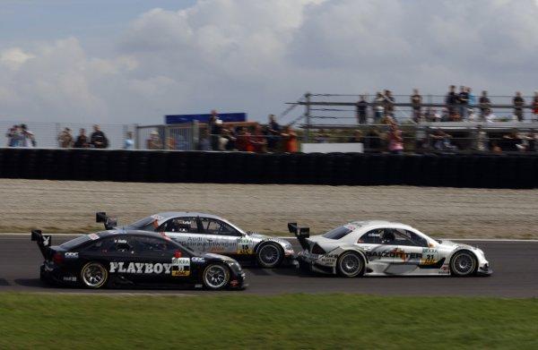 2005 DTM ChampionshipZandvoort, Netherlands. 27th - 28th August 2005Jamie Green (Salzgitter AMG-Mercedes C-Klasse) leads Pierre Kaffer (Joest Racing Audi A4) and Laurent Aiello (Opel Vectra GTS V8). Action.World Copyright: Andre Irlmeier / LAT Photographicref: Digital Image Only