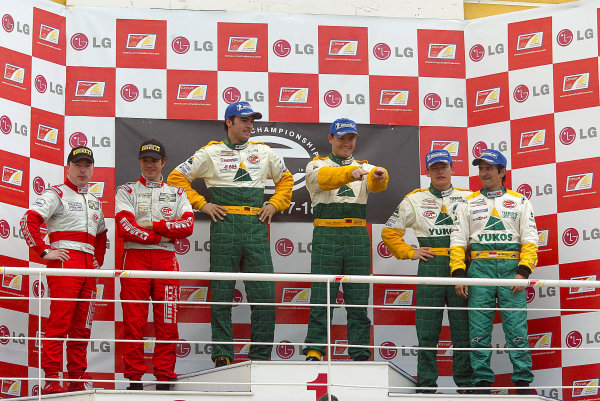 2004 FIA GT ChampionshipValencia, Spain. 17th - 18th April.NGT class Winners Maassen & Luhr (Porsche 996 GT3 RS) on the podium with 2nd placed Pescatori & Simone (Ferrari 360 Modena) and 3rd placed Ortelli & Collard (Porsche 996 GT3 RS).World Copyright: Photo4/LAT Photographicref: Digital Image Only
