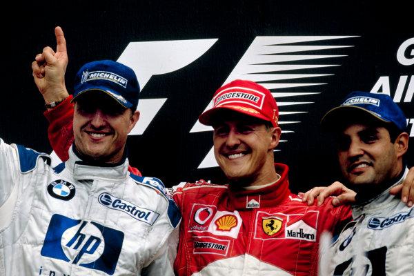 2003 Canadian Grand PrixMontreal, Canada. 13th - 15th June 2003.RAce podium, Michael Schumacher, Ferrari F2003 GA, (1st), Ralf Schumacher, BMW Williams FW25, (2nd) and Juan-Pablo Montoya, (3rd).World Copyright: Steven Tee / LAT Photographic ref: 35mm Image 03Canada23