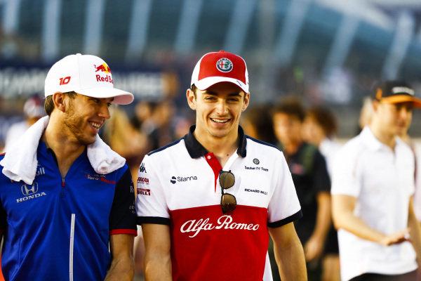 Charles Leclerc, Alfa Romeo Sauber F1 Team, talks to Pierre Gasly, Toro Rosso
