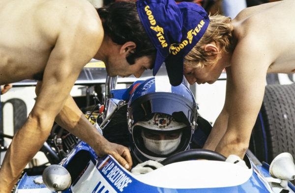 Mechanics strap Jean-Pierre Beltoise into his Matra MS120.