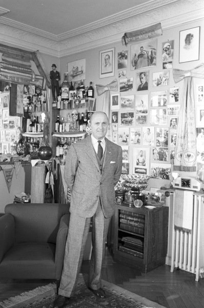 Louis Chiron surrounded by motorsport paraphernalia.