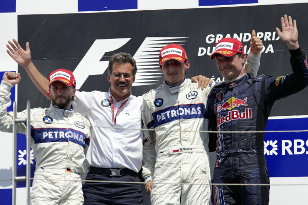 Podium group photo. L-R: Nick Heidfeld, 2nd position, Dr Mario Theissen, winner Robert Kubica and David Coulthard, 3rd position.