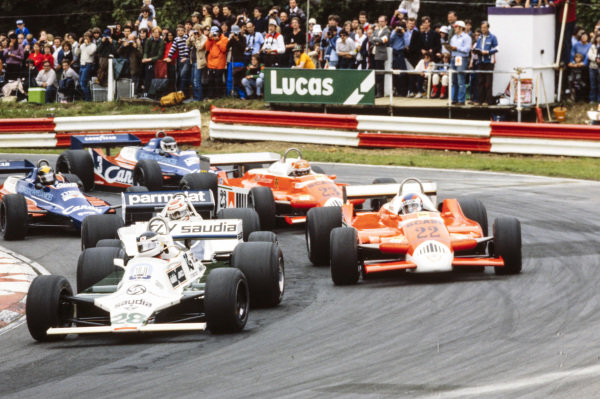Carlos Reutemann, Williams FW07B Ford, leads Nelson Piquet, Brabham BT49 Ford, Patrick Depailler, Alfa Romeo 179, Bruno Giacomelli, Alfa Romeo 179, Derek Daly, Tyrrell 010 Ford, and Jean-Pierre Jarier, Tyrrell 010 Ford.