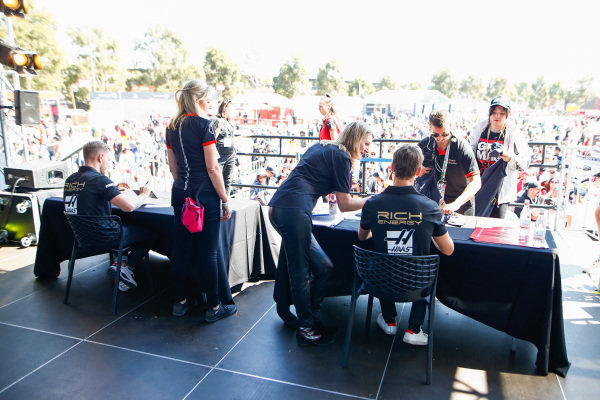 Romain Grosjean, Haas F1 and Kevin Magnussen, Haas F1 signs autographs for fans