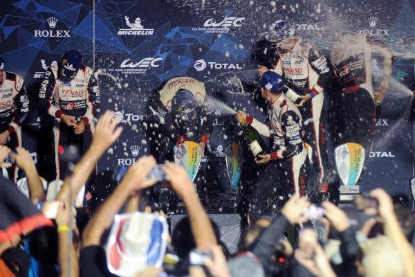 P1 Podium celebrations, #7 Toyota Gazoo Racing Toyota TS050: Mike Conway, Jose Maria Lopez, Kamui Kobayashi and #8 Toyota Gazoo Racing Toyota TS050: Sébastien Buemi, Kazuki Nakajima, Fernando Alonso Hartey