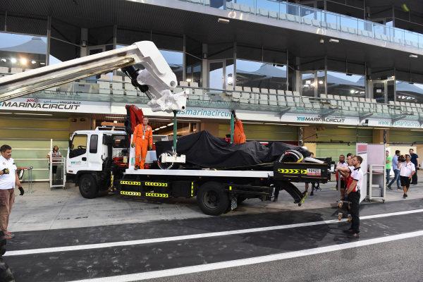 The car of Kimi Raikkonen, Alfa Romeo Sauber C37 is recovered to the pits
