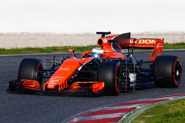 Circuit de Barcelona Catalunya, Barcelona, Spain. Monday 27 February 2017. Fernando Alonso, McLaren MCL32 Honda, carries sensor equipment.  World Copyright: Zak Mauger/LAT Images ref: Digital Image _L0U9846